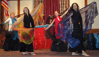 Dancers perform at a belly dance recital