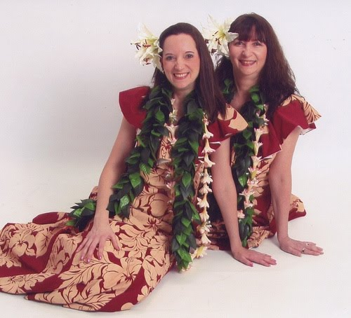 Hula instructors Bev and Dawn in red hula costumes