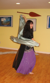 Maia demonstrates a spin with a veil
